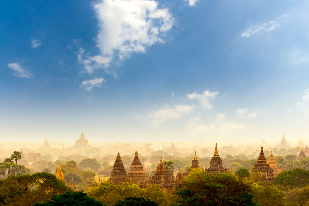 landscape view of temples with blue sky in the background