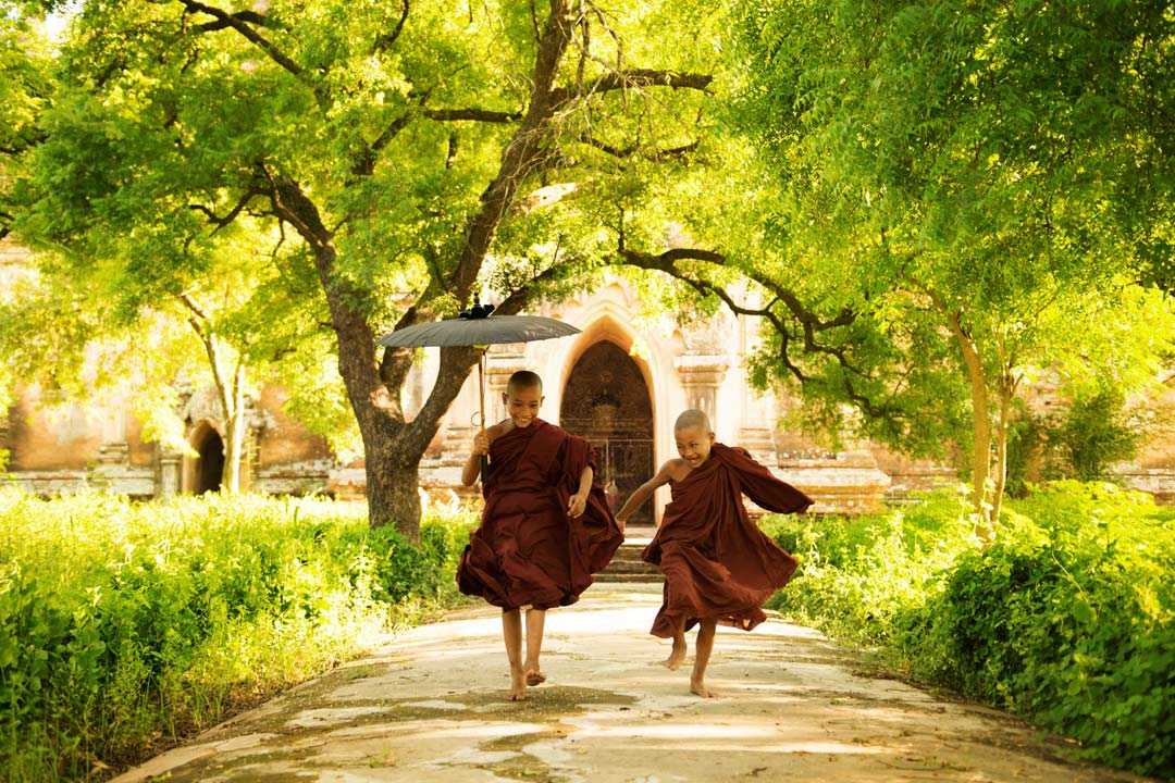 2 young monks walking down a path
