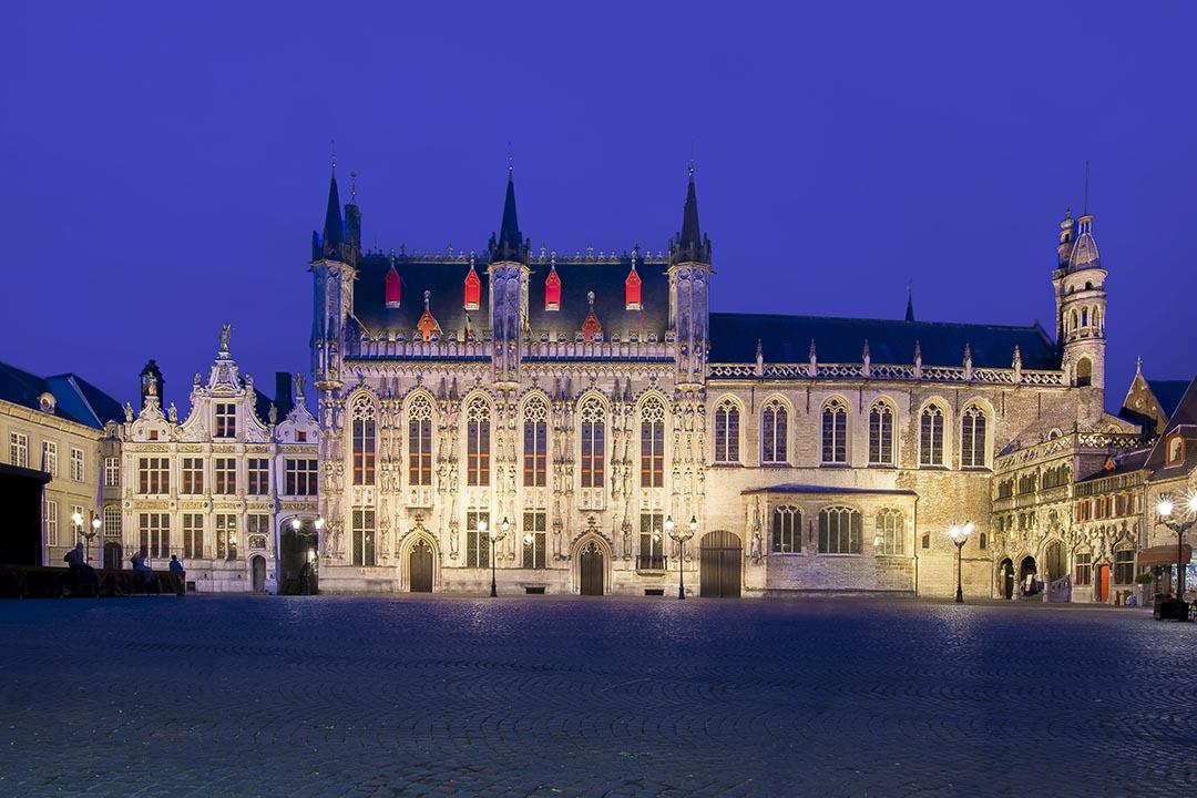 Bruges City hall at Burg square at night.