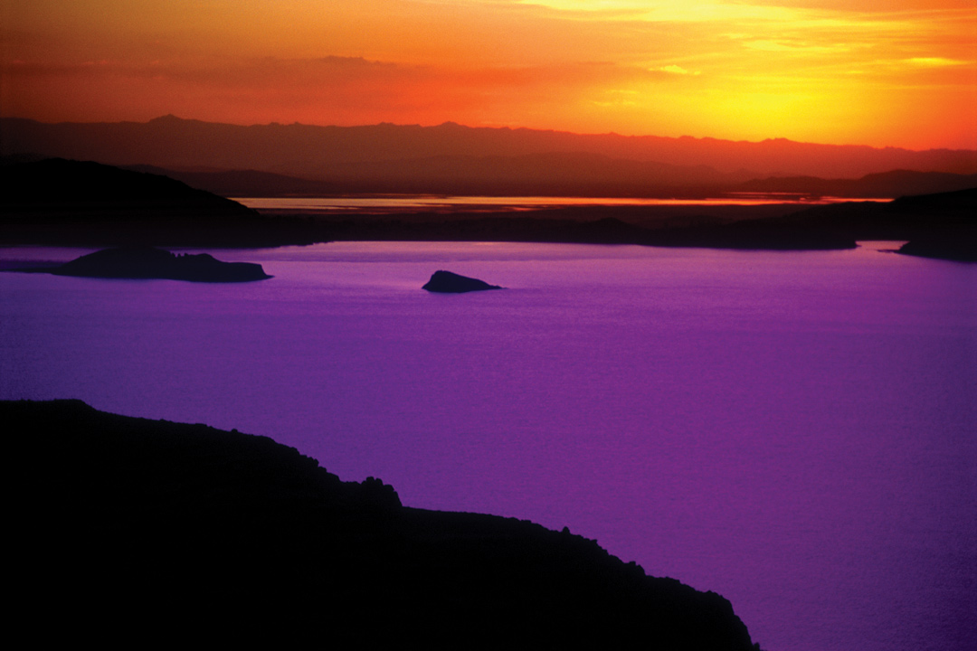 Pink lake with orange sky in the background