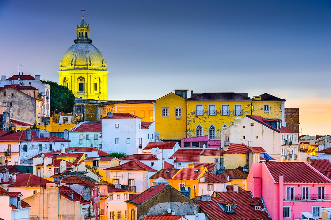 Lisbon, Portugal skyline at Alfama, the oldest district of the city with the National Pantheon Dome.