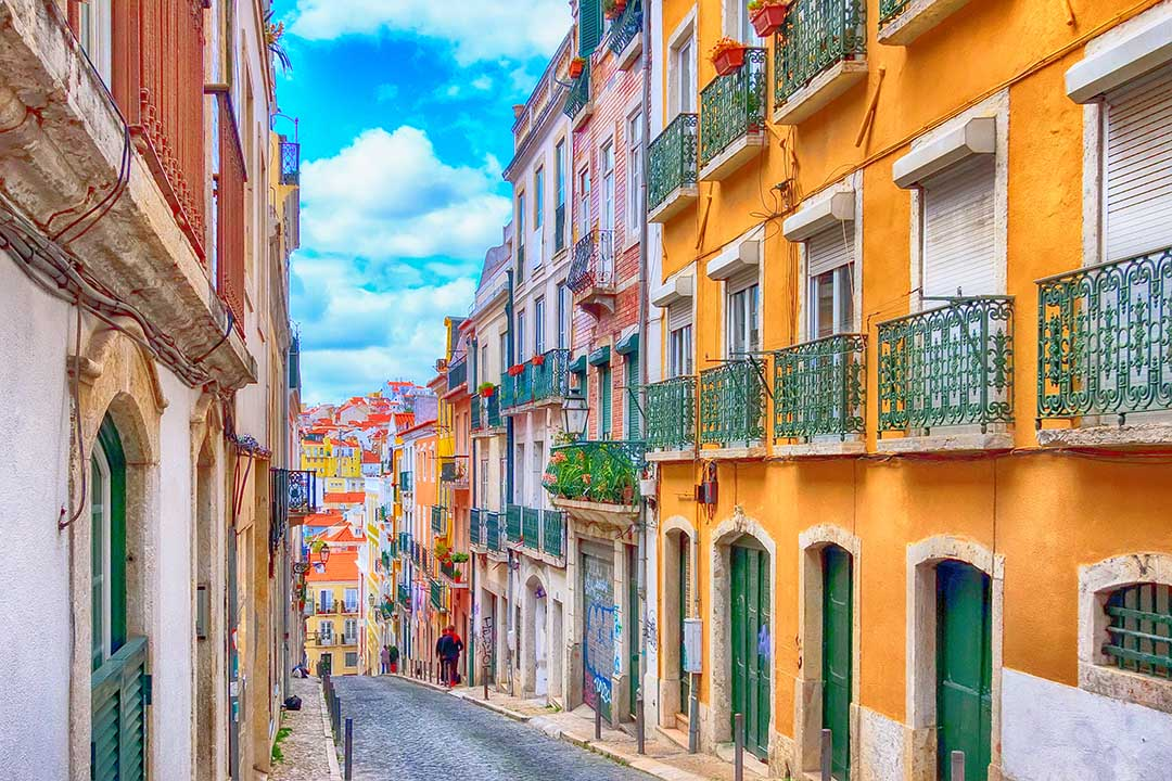 Lisbon, Portugal street perspective view with colourful traditional houses