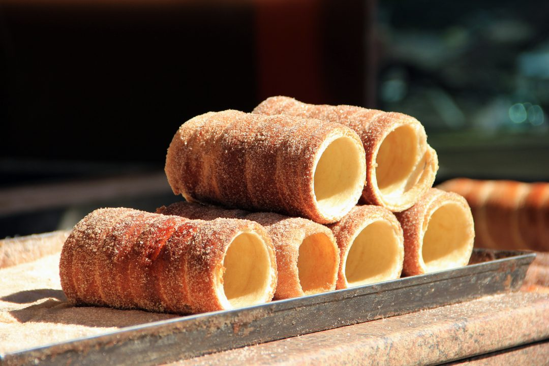 Trdelnik pastries stacked one on another in Prague, Czech Republic.