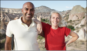Amar, wearing a white polo shirt, stood with Sara, in a red t-shirt, in Cappadocia.