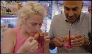 Sara and Amar sampling traditional Turkish drinks.