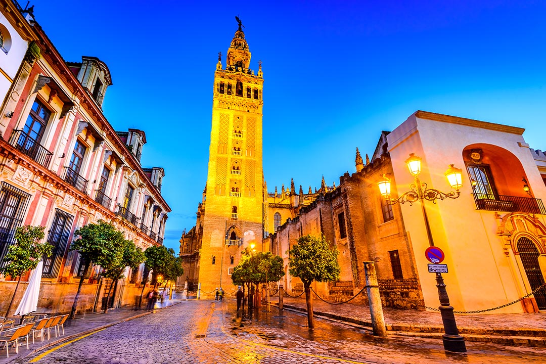 La Giralda in the twilight with pedestrianised square in the foreground