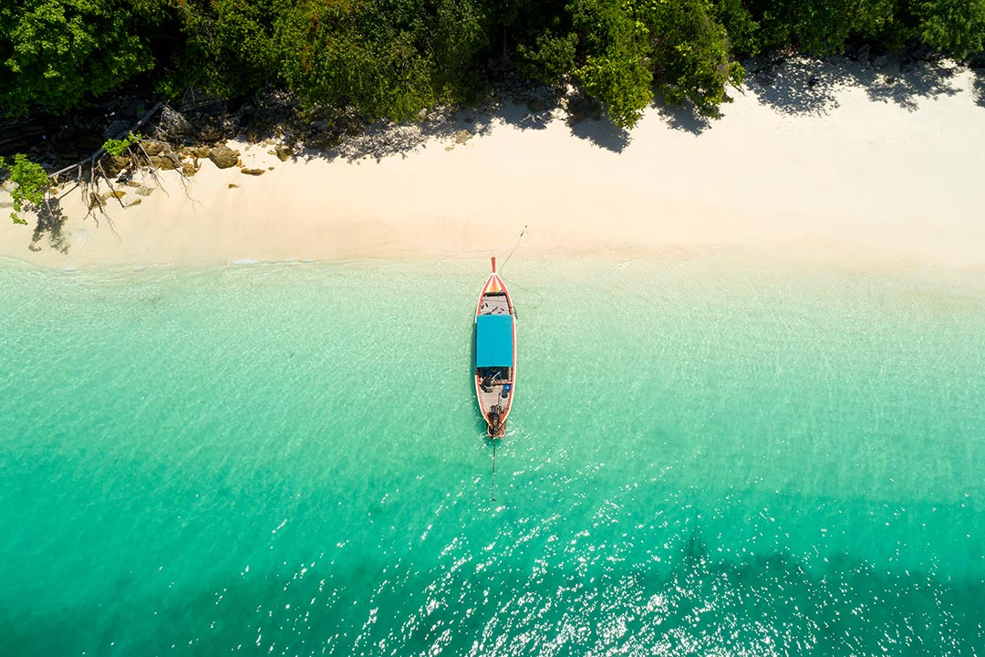 Long tail boat on the beach. Aerial view from Andaman beach.