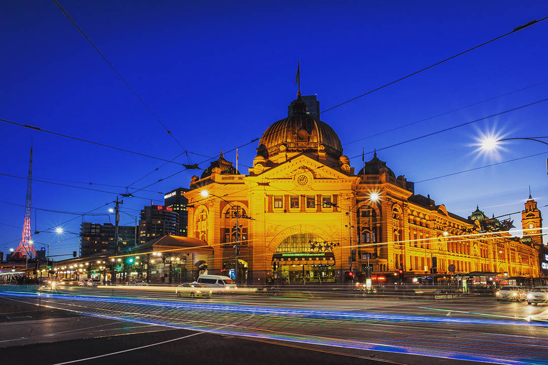 Flinders street station illuminated as the night draws in.