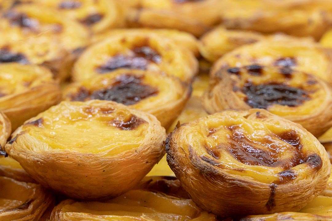 Portuguese custard tart is a Portuguese egg tart pastry dusted with cinnamon. Crusty and flaky on the outside and creamy on the inside.