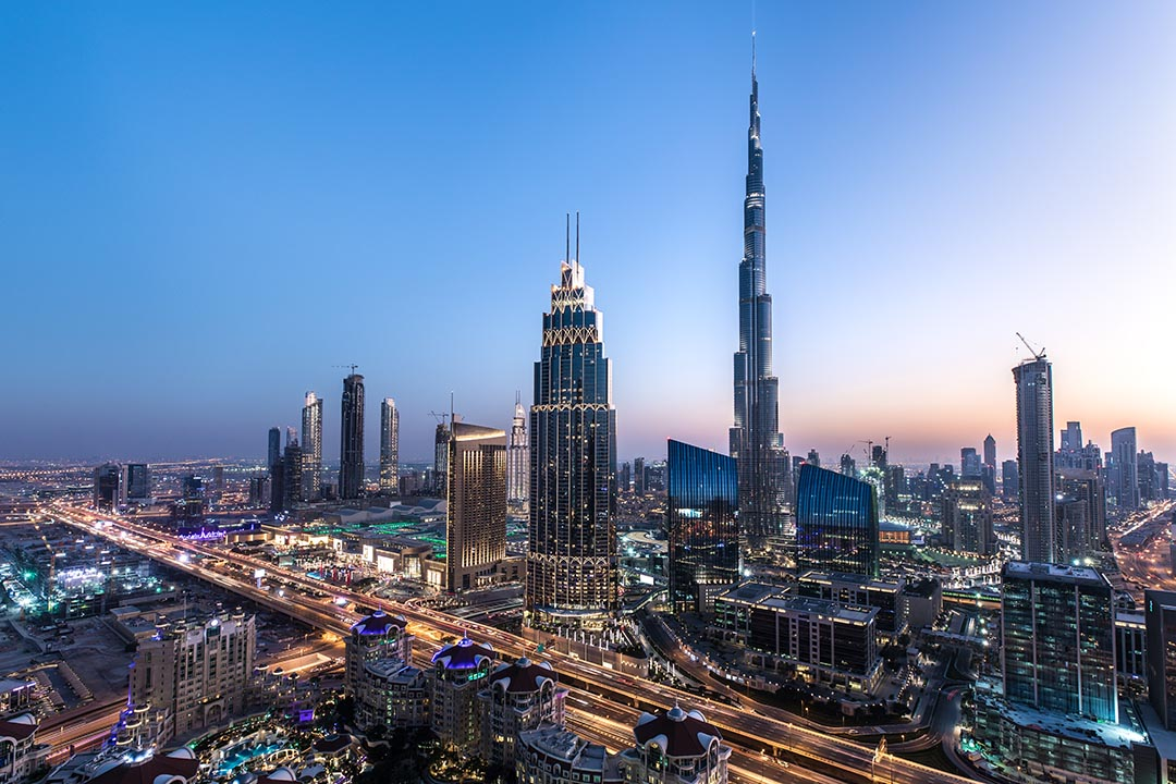 Blue hour view of Dubai Downtown architecture after winter sunset.