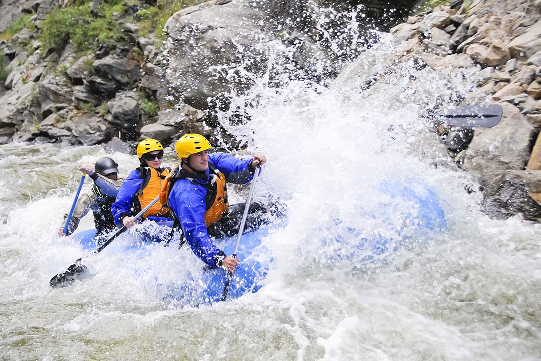 A group of friends whitewater rafting