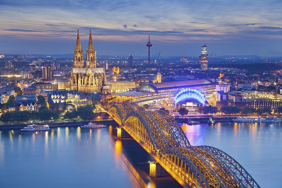 Image of Cologne with Cologne Cathedral during twilight blue hour.