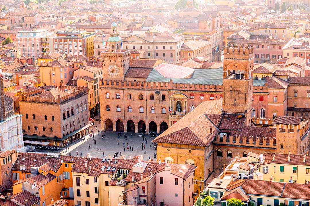 Aerial view of Bologna, orange hued buildings with a central square
