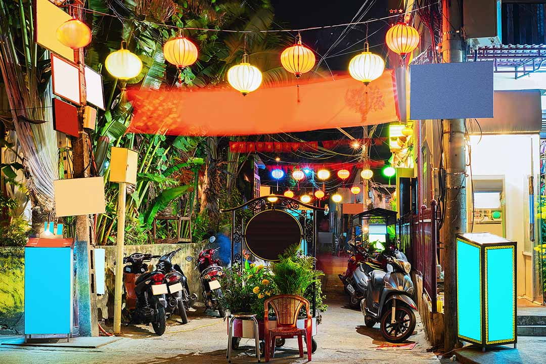 Motorcycles and the street of old city of Hoi An, Vietnam