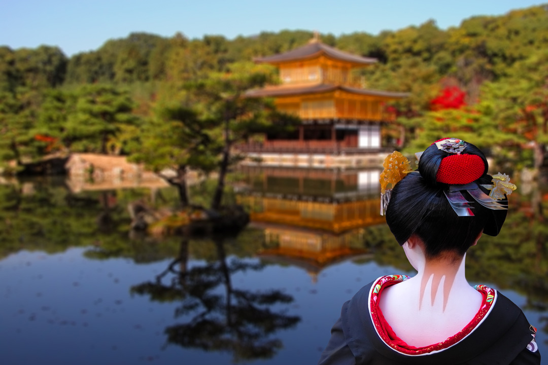 Image of a geisha looking over a lake towards a temple.