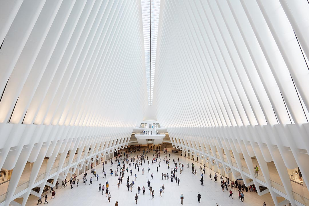 Oculus interior of the white World Trade Center station with people in New York