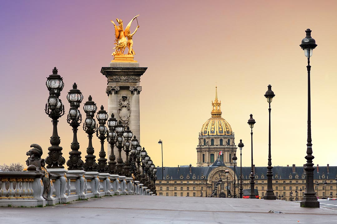 Beautiful sunrise at the Pont Alexandre III and Les Invalides in Paris.