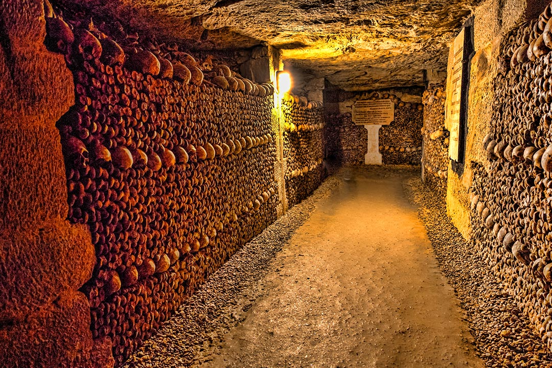 The Realm of the Dead, the Catacombs of Paris, or Catacombes de Paris, are underground ossuaries in Paris, France. Halls and caverns of walls of carefully arranged bones and skulls of over 6 million people.