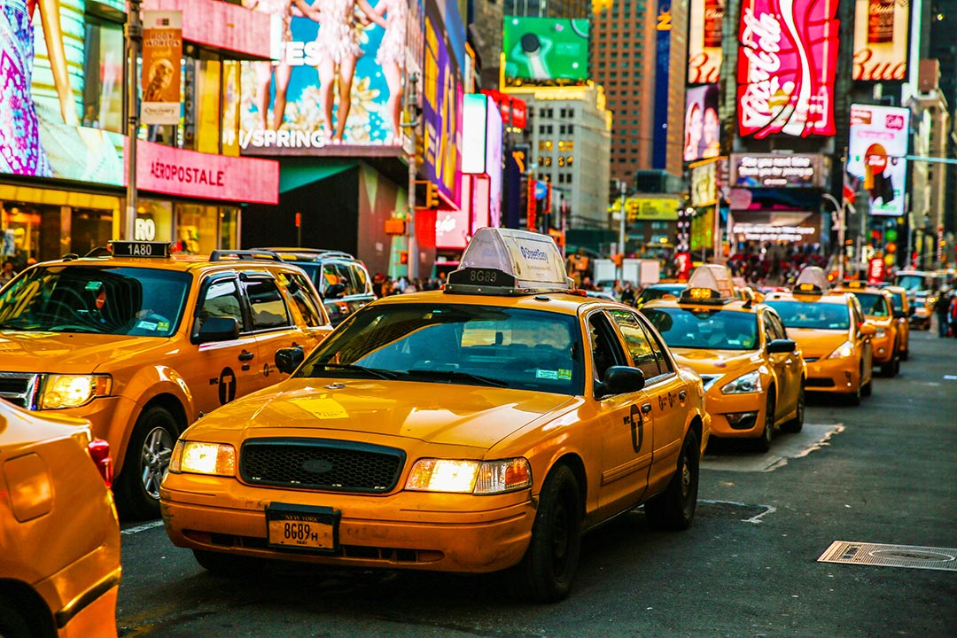 Yellow taxis on 7th Avenue at Times Square, New York City