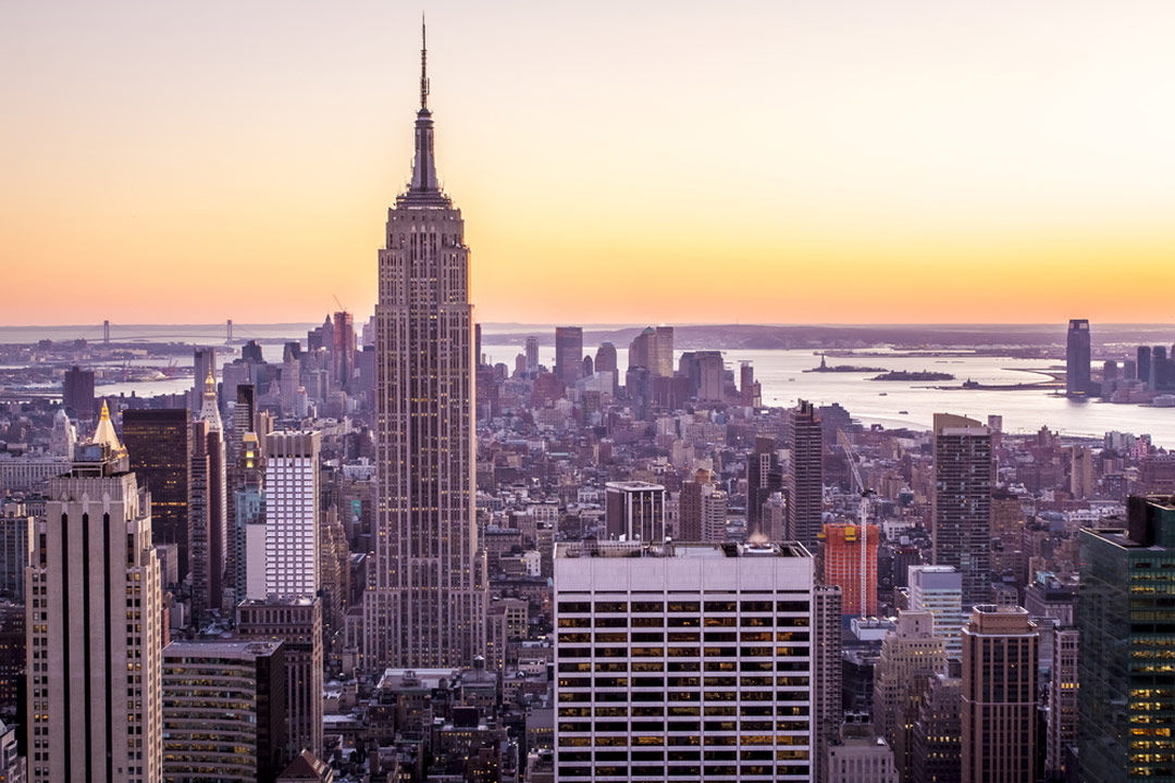 A view of the Empire State Building and Manahttan at sunset from the Rockefeller Centre.