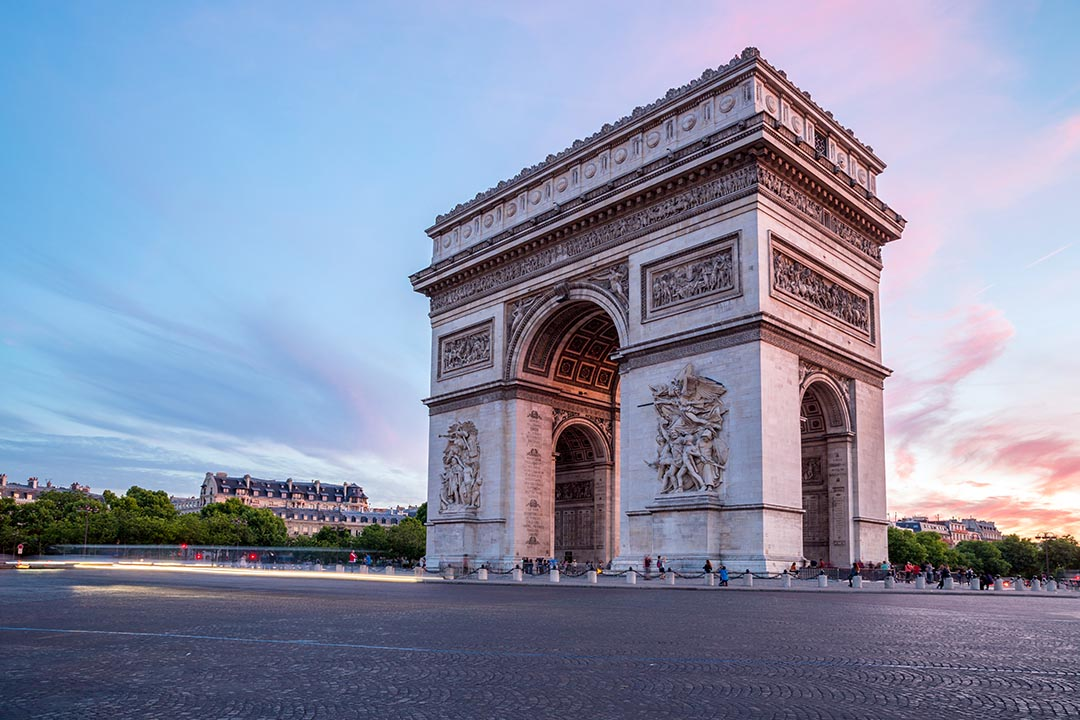 Arc of Triomphe on the Champs Elysees in Paris at sunset.
