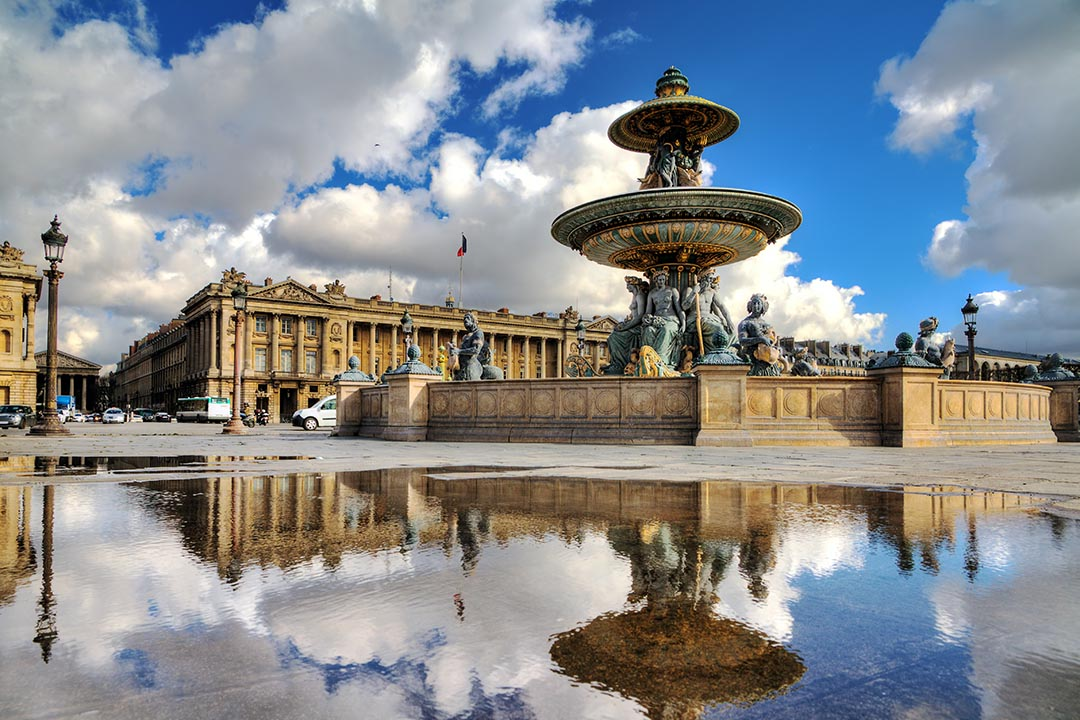 Beautiful reflection of the fountain at Place de la Concorde in Paris, France.