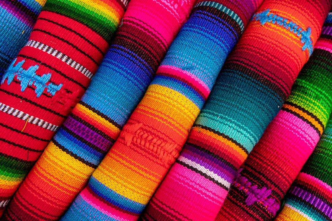 Vibrant coloured fabric at the markets of Mexico.