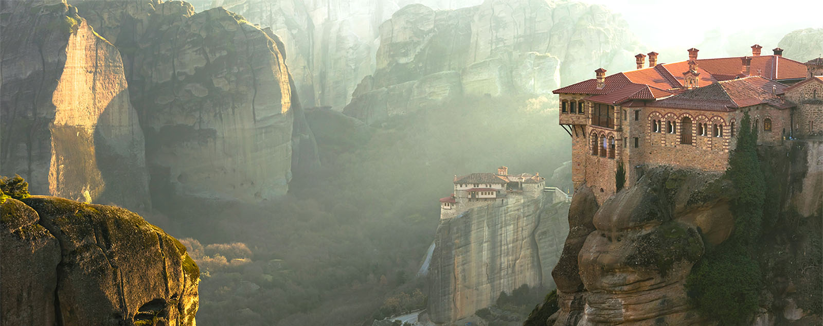 Two monumental monasteries sitting on top huge pillars of rock