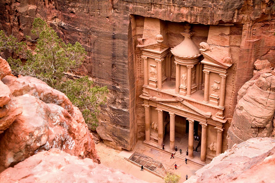 The Treasury in the ancient city of Petra carved out of the red coloured rock.