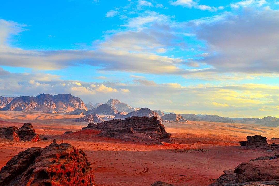 Sunset in Wadi Rum with a view over the red lunar-like landscape.