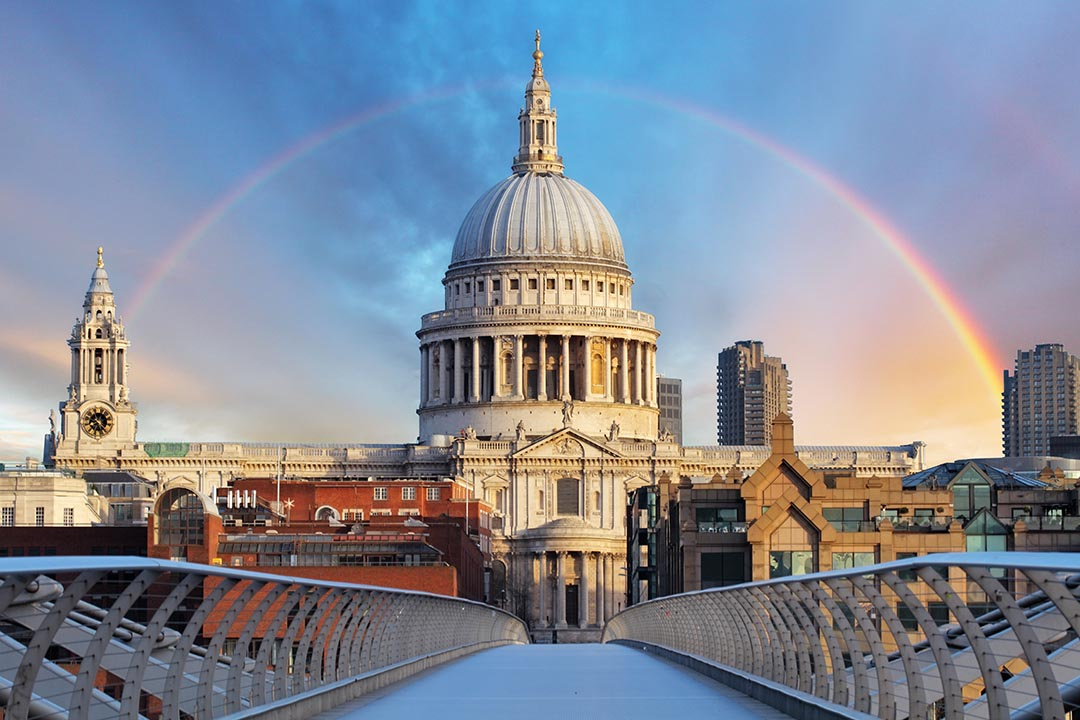 St Paul's Cathedral from Millenium Bridge. This is at dawn with a rainbow over St Paul's Cathedral.