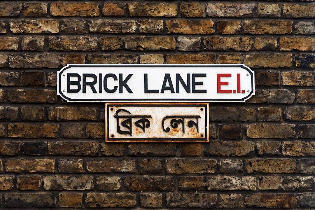 A black and white Brick Lane Street Sign.