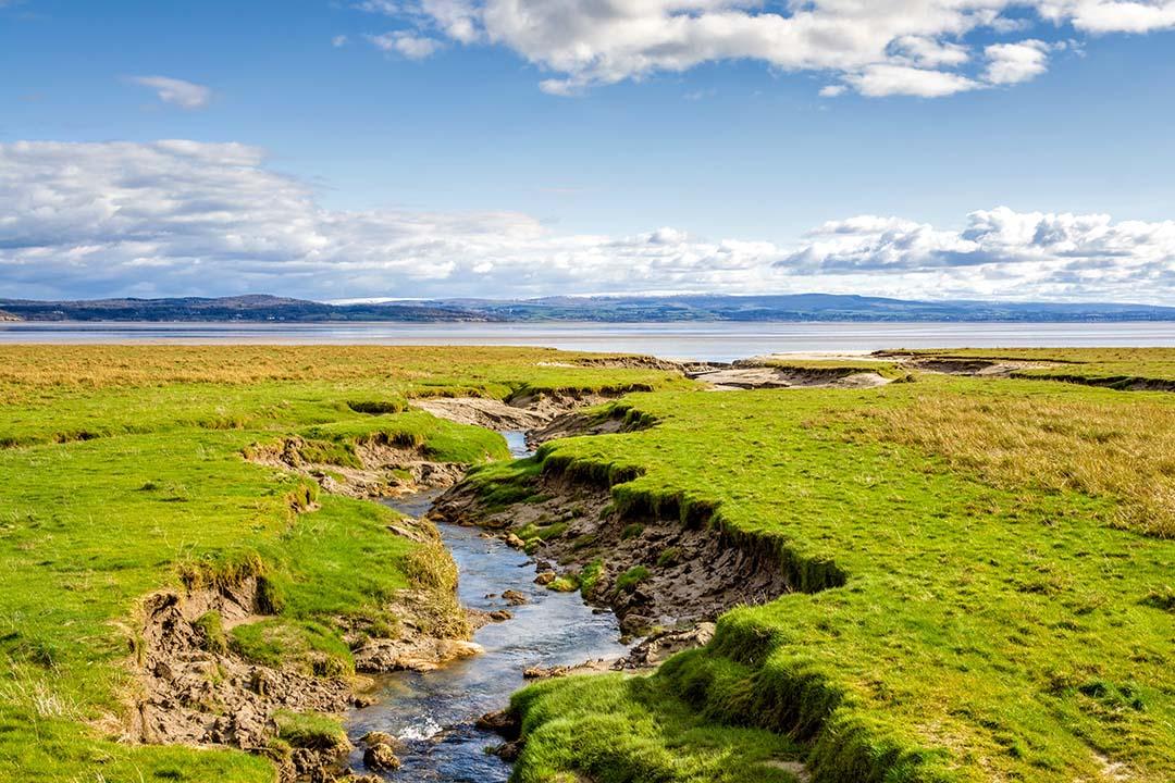 Coastline near Grange-over-Sands, a stream runs to the nearby ocean