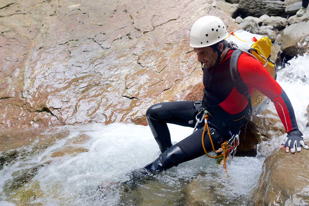 A man in the midst of canyoning