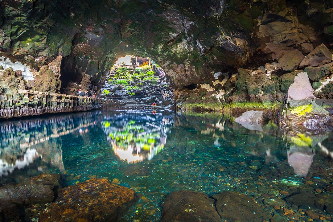Beautiful cave reflected in the water in Jameos del Agua