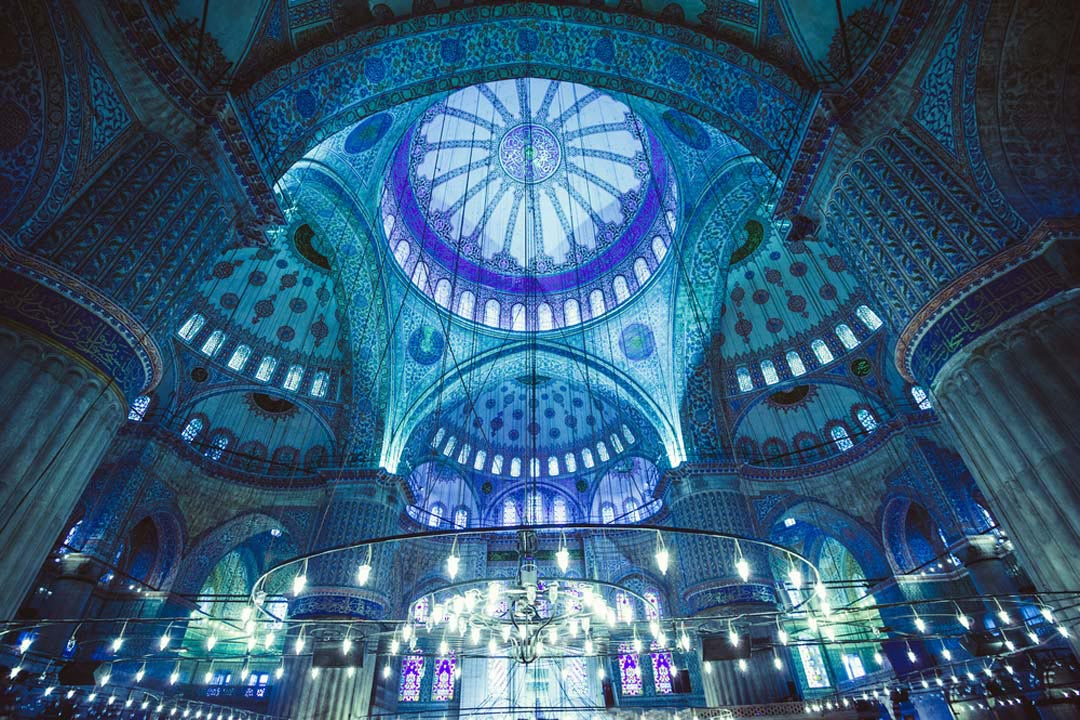 The intricate blue mosaic pattern in the blue mosque