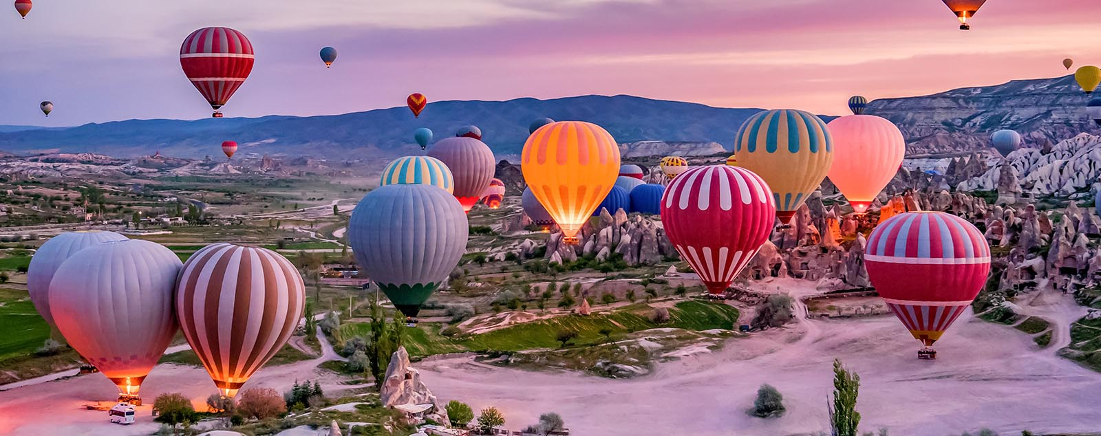 Colourful hot air balloons before launch at sunrise in Goreme national park, Cappadocia, Turkey