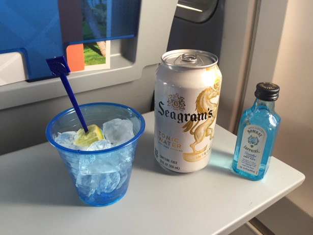 Free gin and tonic on a long haul flight table