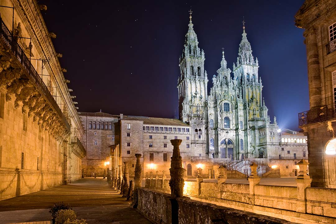 An exterior view of the Santiago de Compostela Cathedral at night