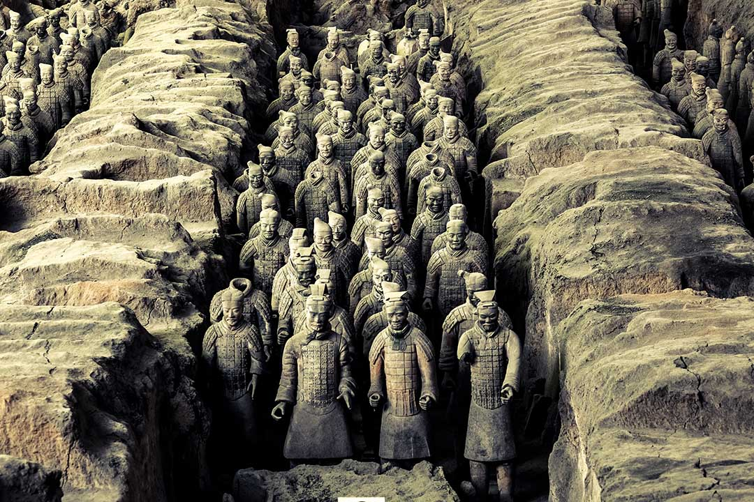Terracotta Warriors of Xian China lined up between rock trenches