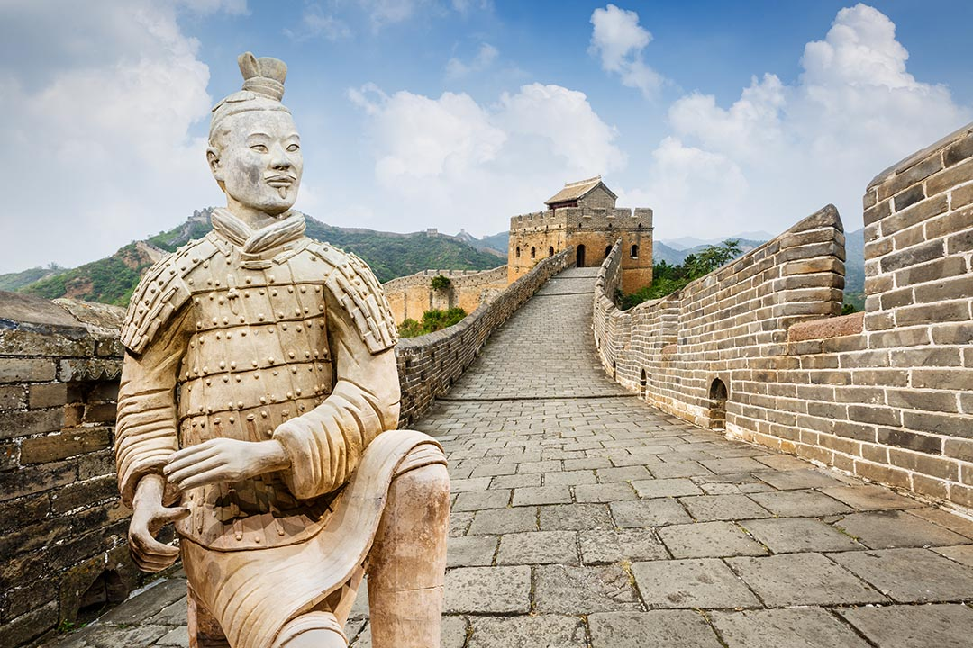 spectacular Great Wall of China in Beijing, a terracotta warrior kneels on the wall
