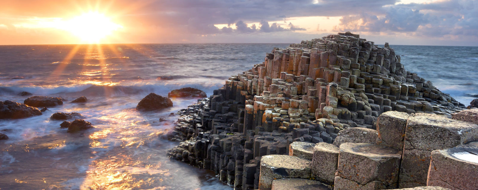 The Giant's Causeway lit by a golden sunset