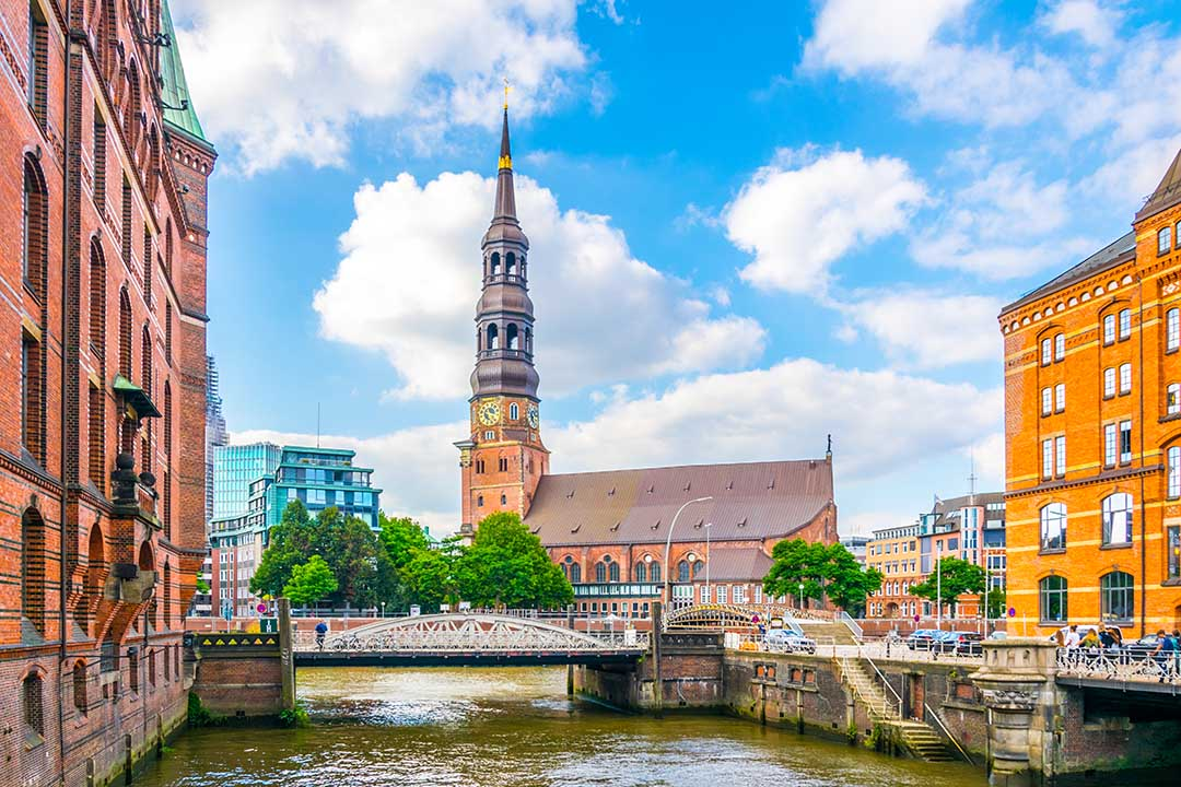 View of the St. Katharinen Church in Hamburg, situated behind a bridge over the canal