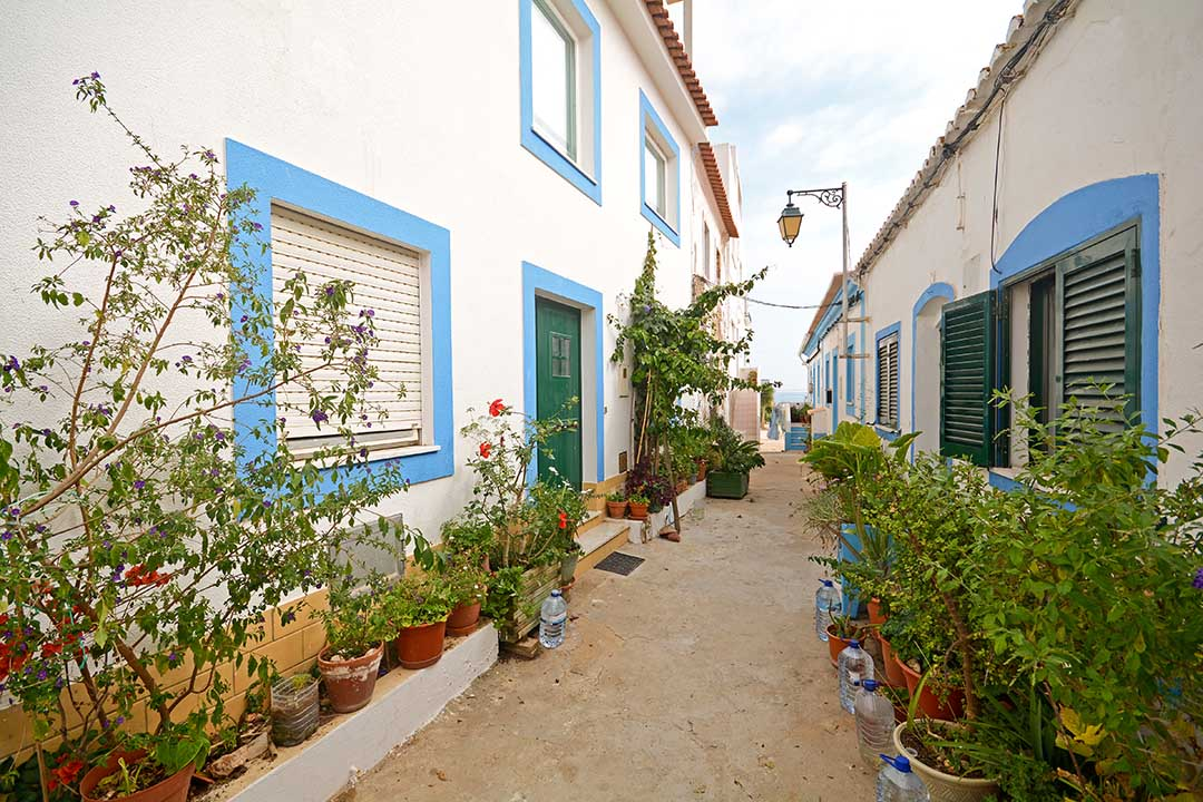 Small alley in a local fishing village in the Algarve