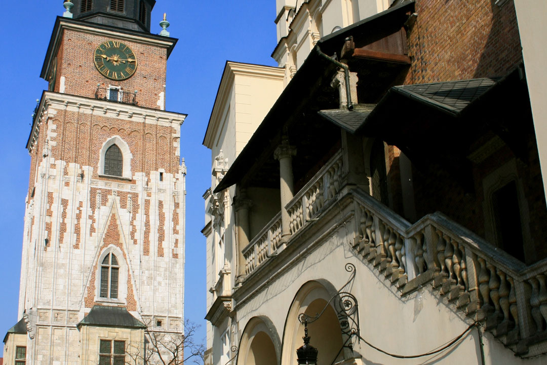 A medieval Polish building with outside steps leading up to the 2nd floor.
