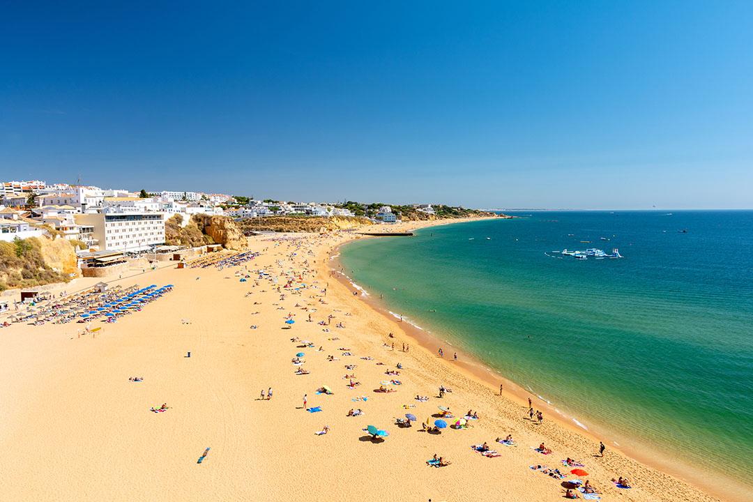 view on sandy beach in Albufeira in Algarve, Portugal