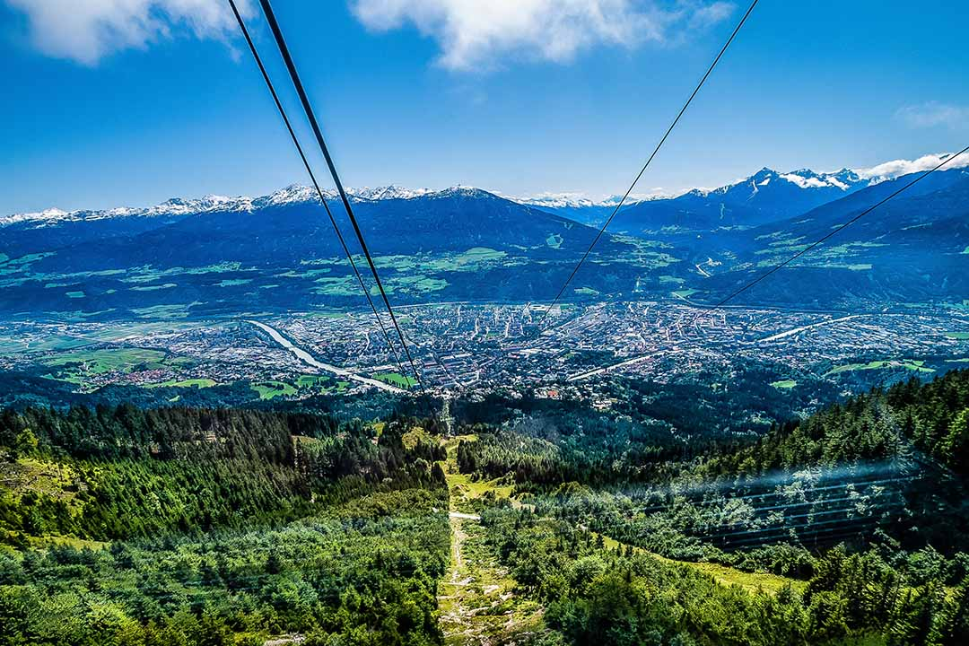 A view down the cable car route, showing panoramic views over Innsbruck