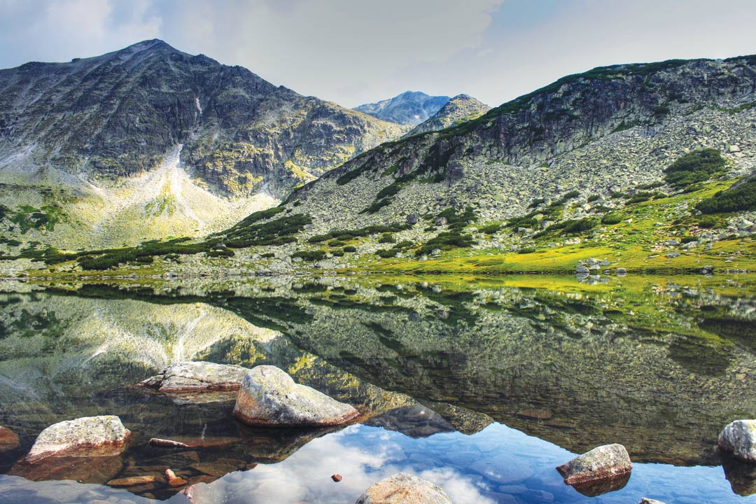Breathtaking mountains reflected against perfectly still waters