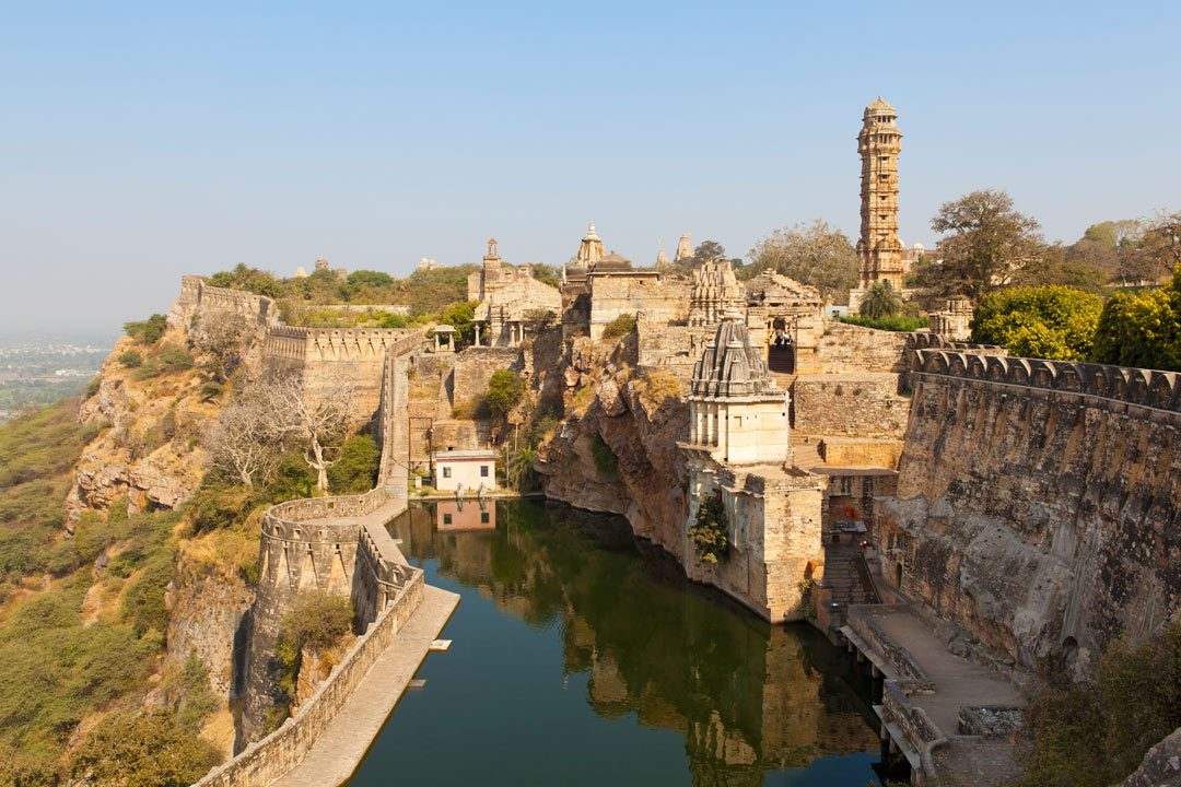 A series of medieval yellow fortifications on a hilltop citadel called Chittorgarh