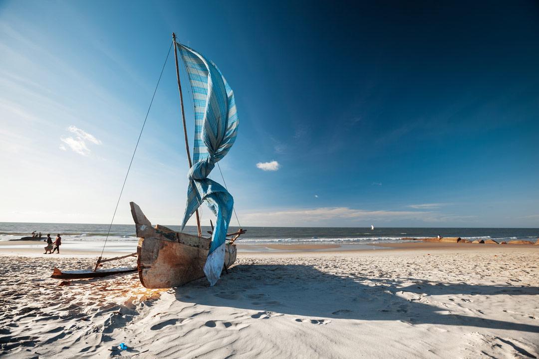 A local fishing vessel on a powder white sand beach